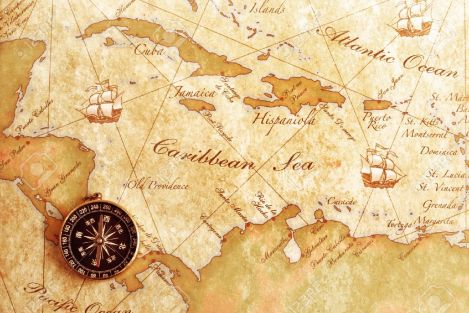 13573041-An-old-brass-compass-on-a-Treasure-map-background-Stock-Photo-map-nautical-history.jpg